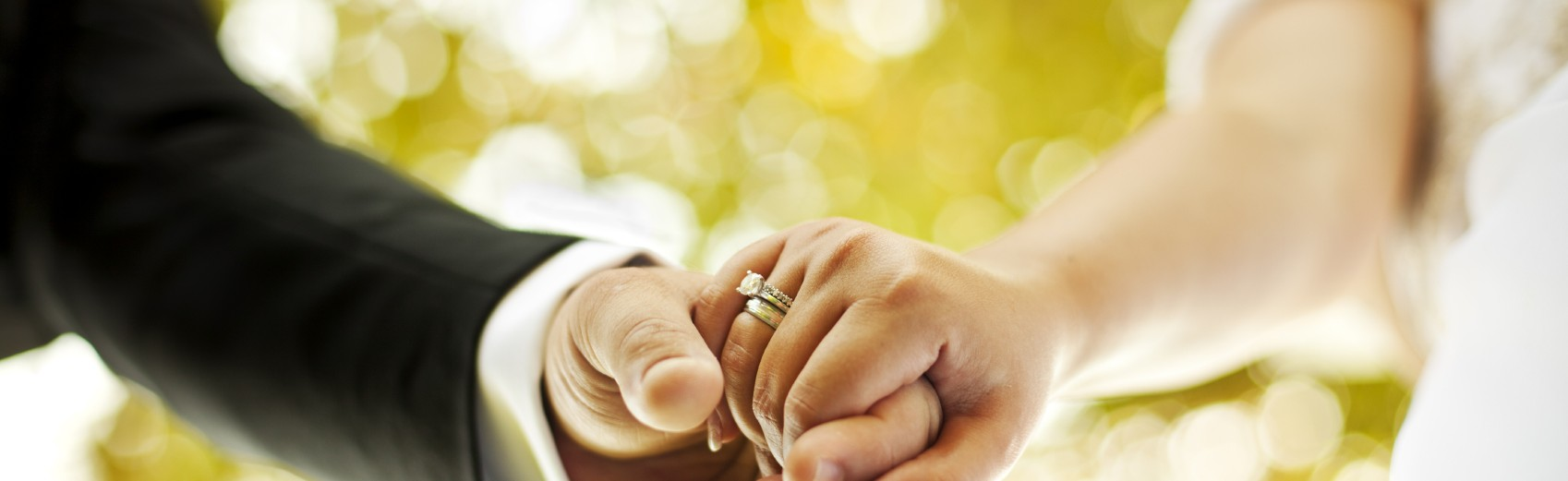 130 Visa     Petitions for the Immigrating Spouse of an American    Wedding Rings Holding Hands